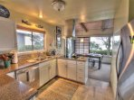 Stainless steel and granite counter-tops in the kitchen.