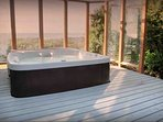 A private hot tub with a view of the Pacific.