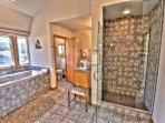 Huge tile shower and Jacuzzi in Master bath.