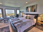 Spacious bedroom with ocean view.