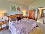 Sunlit master, crisp linens, and classic furnishings.