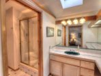 Master bath with skylight and beautiful tile step-in shower.