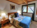 Quiet downstairs bedroom, Queen size comfort, and peaceful privacy .