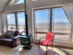 Living room area looks out over the ocean for a view that can't be beat.