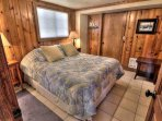 Queen Sized comfort and warm wood paneling.