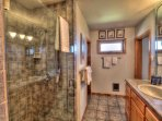 An elegant tile bath with walk-in shower.