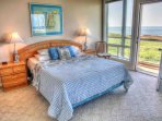 Traditional furnishings and deck access in the bedrooms.