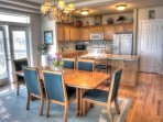 An open floor-plan invites in the dining room kitchen