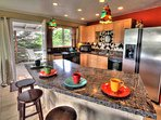 Stylish, well equipped kitchen with granite counters.