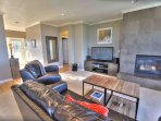 The home has a gas fireplace, and modern furnishings.