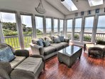 A window lined sun-room is perfect for watching waves, and whales