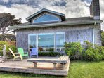 This adorable beachfront cottage invites you to vacation in peace and quiet.