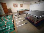 Pool, Foosball and a first-class ping-pong experience in the game room .