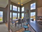 Floor to ceiling windows and ocean front view in the downstairs great room.