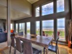 Enjoy the floor to ceiling windows and ocean front view in the downstairs great room.