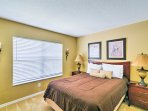 This bedroom includes a queen-sized bed and flat-screen TV.