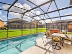 Catch some sun out on the screened-in lanai.
