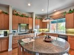 The kitchen features modern appliances and granite countertops.