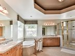 The massive en-suite master bathroom offers a walk-in shower and a separate tub.