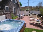 View from the hot tub overlooking the private patio - 201 Main Street Chatham Cape Cod New England Vacation Rentals