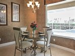 This 4-person dining table is a great spot to enjoy a cup of coffee with your loved ones.