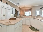 Ample counterspace, including a center island will make cooking a breeze!
