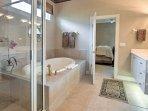 Soak in the bath tub or rinse off in the walk-in shower of the en-suite bathroom.