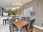 Wine and dine at the 6-person dining table.