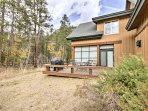 Mountain views and tall trees surround this Rocky Mountain abode.