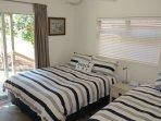 Side bedroom - Queen and King Single. Ceiling fan. Verandah access