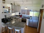 Fully equipped kitchen with ice maker, Dishwashers, Nespresso machine, serving platters