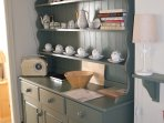 Dresser displaying vintage crockery