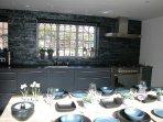 The high spec kitchen has integral Bosch appliances