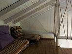 Loft space with pillows and mattresses suitable to sleep an additional two more children