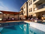 Heated Jacuzzi and pool, comfortable sun deck area and lounge corner