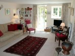 The large sitting room opens out onto the garden