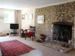 The original stone fireplace is an impressive decorative feature
