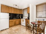 Immaculate Kitchen with Dining Area and Window AC
