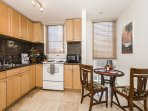 Immaculate Kitchen with Dinning Table and Window AC
