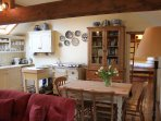 The dining area and kitchen beyond