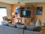 The living room features a flat-screen cable TV.
