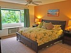 The private bedroom features a plush a king bed.