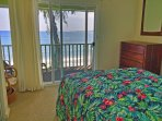 This bedroom opens up to the private upper-level lanai.