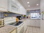 Fully equipped kitchen with all items necessary to prepare and serve a meal.