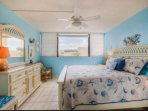 Coastal inspired decor in the guest bedroom complete with a king size bed.