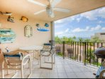 Take in the beautiful scenery on your private screened in balcony with outdoor seating for 4 guests.