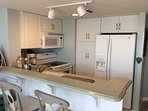 FULL EQUIPPED KITCHEN WITH DISHWASHER, COFFEE POT, MICROWAVE, POTS, PANS, PLATES, FLATWARE, GLASSES,