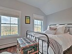 Two guests will sleep well in the master bedroom, which features a queen-sized bed.