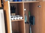Kitchen cabinet including flatware and dishes