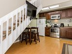 Fully Equipped Kitchen, Table and Stairs to Loft